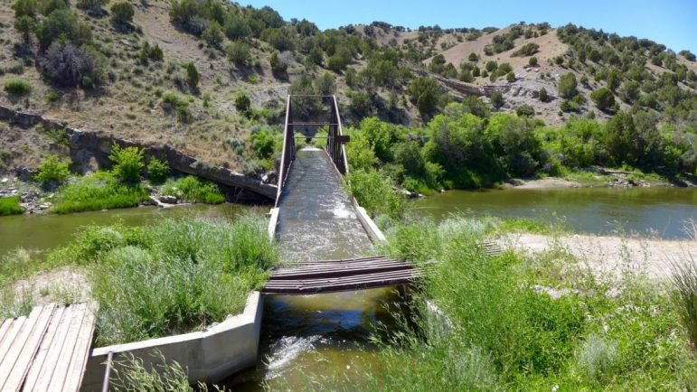 Water diverted into the Maybell Canal enters a flume a mile below the headgate and crosses the Yampa River. A remote-operated outlet is to be installed just above the flume in an effort to reduce diversions into the ditch.