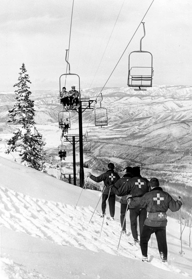 The Aspen Highlands ski patrol, about 1980, ski-packing under the Loge Peak lift.