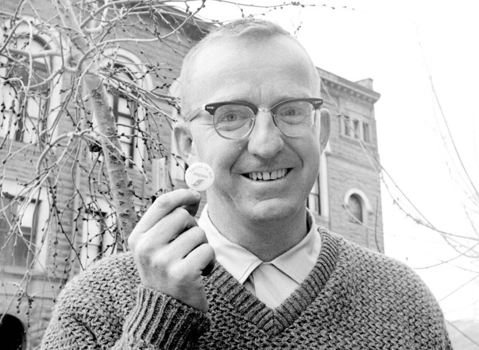 John Kerrigan, the Aspen city manager, or administrator, in 1965. He appears to be standing outside of the Wheeler Opera House and holding a button that says, for some reason, 'There is no Aspen.'