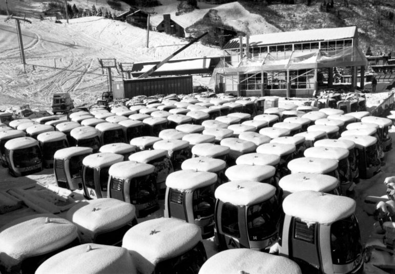 Rows of snow-covered cabins wait to be put on the cable before the opening of the Silver Queen Gondola for the upcoming 1986-'87 ski season. The 'clam shell' cars were the predecessors of today's cars, which have the seats facing inward. The photo is dated November 13, 1986.