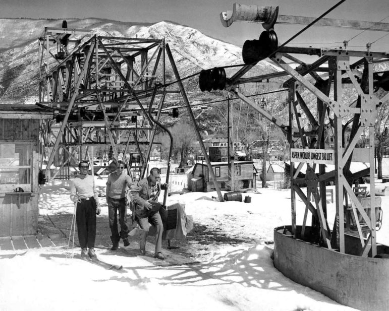 Gary Cooper, without ski gear, catching a chair at the bottom Lift 1 in 1950. Friedl Pfeifer, is standing, left, on skis.