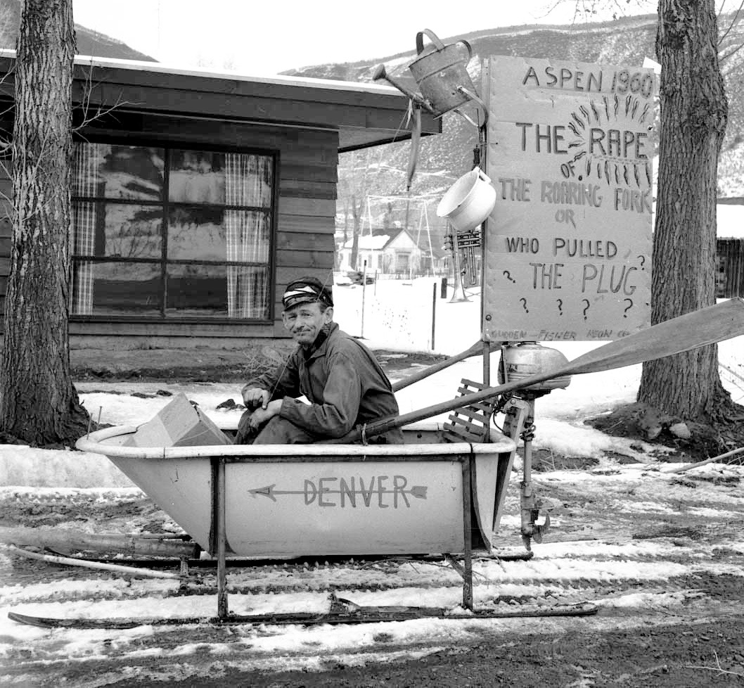 Freddie Fisher in his 1954 Winterskol float. Fisher was a professional musician who ran a ramshackle fix-it shop and yard in Aspen and sent in a regular stream of witty letters to The Aspen Times. In the mid-1950s, the proposed Fryingpan-Arkansas project was being reviewed at the local, state and federal level, and Aspenites were concerned about the amount of water that would be diverted from the Roaring Fork River watershed, on top of the amount already being diverted by the Twin Lakes-Independence Pass project.