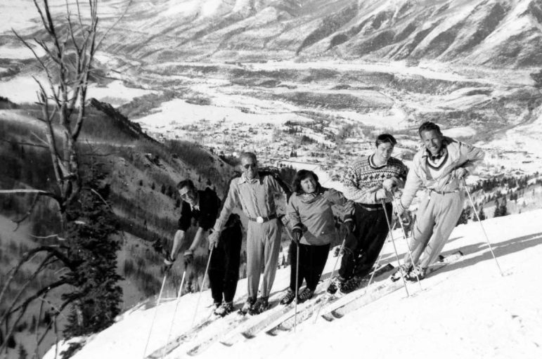 Skiing on Bell Mtn., 1948. From left to right are Fred Denton, Jerry Wallin (manager of the outdoor skating rink), Jane Duffy, Bob Jones, and Jim Snobble. To their right is the now-named 'Hanging Tree' of the 'Hanging Tree Line.' Below them, Aspen is visible.