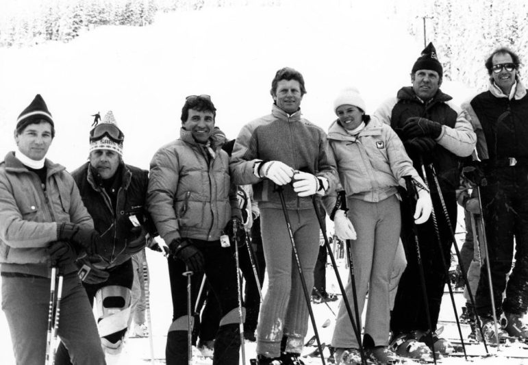 Seven Former Olympic Ski racers pause for a photo in Aspen on December 8, 1983. They are (l to r) Ni Orsi, Rod Hebron, Jimmie Heuga, Stein Erikson, Kiki Cutter, Moose Barrows and Stefan Kaelin. Hebron wears a 'Sab's' hat, short for the one-time locals' favorite Sabbatini ski shop run by Dexter Williams.