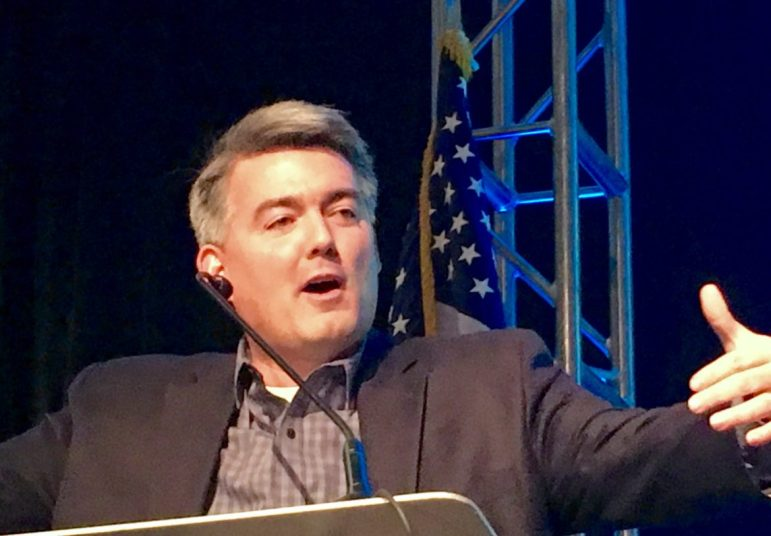 Republican U.S. Senator Cory Gardner speaking Friday morning at the Colorado Water Congress in Denver as about 70 protestors chanted slogans and carried signs outside of the Hyatt Regency hotel in the Denver Tech Center. Gardner said he has been responsive to his constituents while protesters said they were not getting proper access to him or his offices.