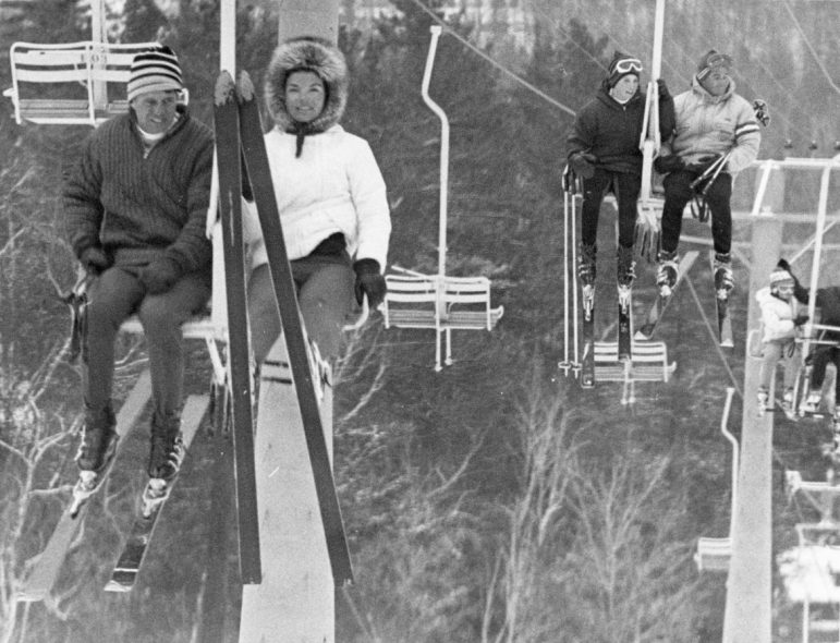 In December 1964 and January 1965, members of the Kennedy family came skiing in Aspen. Seen on a lift are, left to right, Robert Kennedy, Jacqueline Kennedy, two unidentified people, and Caroline Kennedy.