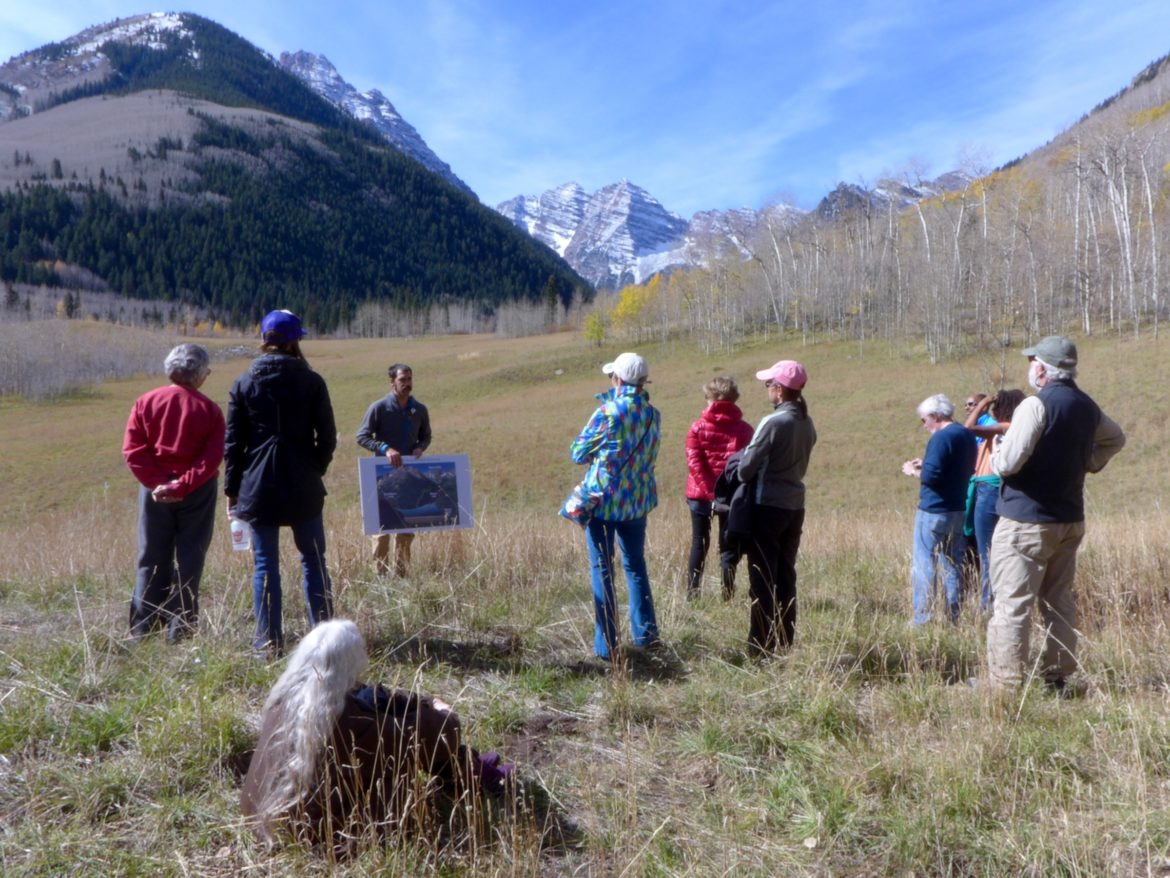 A group of citizens during a site visit in September standing in the meadow near the Maroon Bells that would be flooded by a potential 155-foot-tall dam across Maroon Creek. State officials have recently questioned the city of Aspen's claims to extend conditional water rights for the dam, and another one on Castle Creek, for another six years.