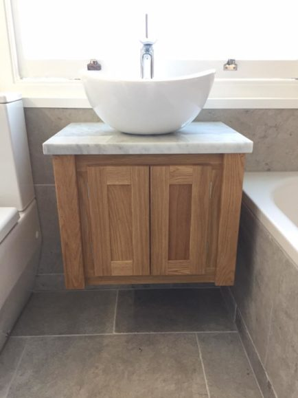 Solid oak wall hung vanity unit with carrara marble top