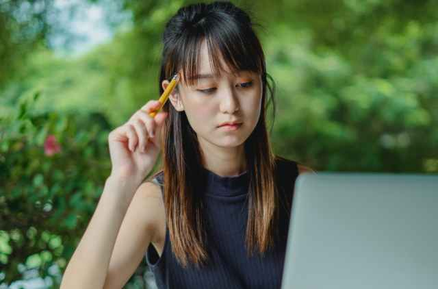 pensive young woman with netbook