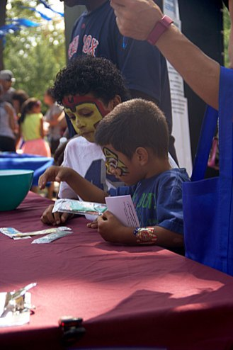 Face-painted Children in Deep Concentration