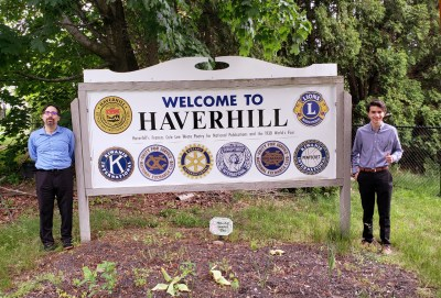 Josiah Morrow (r) and Daniel Rajczyk (r) with Haverhill welcome sign