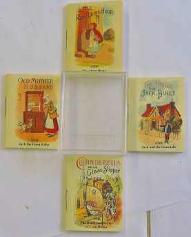 Lot 730 - four very miniature books in a plastic case