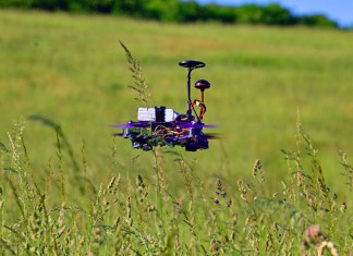 A drone hovering over a field