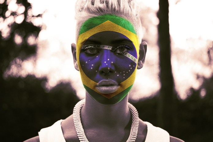 A Brazil fan with face make up | Aspioneer
