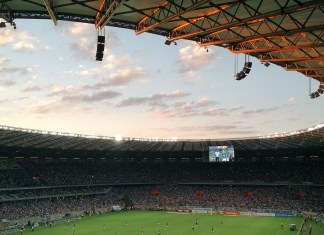A football stadium at almost dusk | Aspioneer