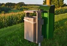 Garbage buckets on a pole | Aspioneer
