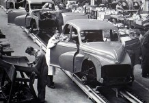 An assembly line of cars | Aspioneer