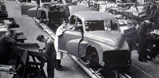 An assembly line of cars   Aspioneer