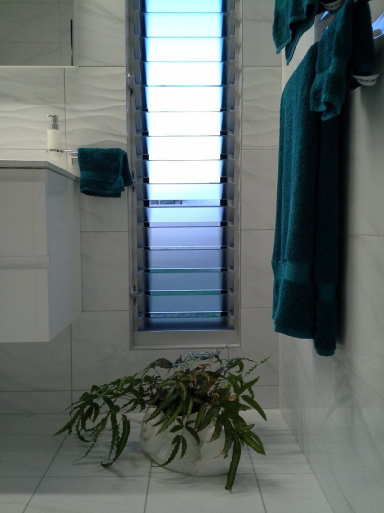 Louver windows have great air flow Louvers with flyscreens motorised