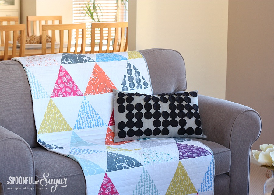 Mormor Triangle Quilt draped on sofa