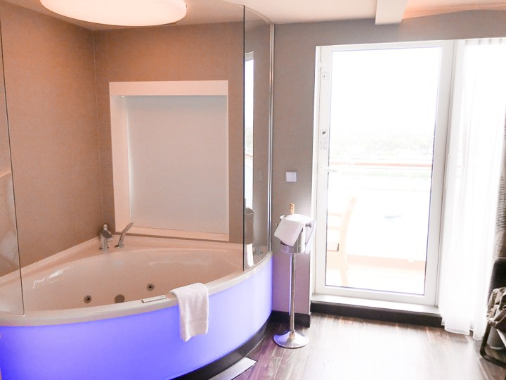 Jacuzzi tub near balcony in Haven Spa Suite