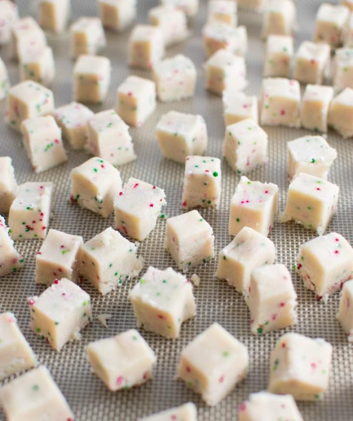 Closeup of cookie dough cubes on baking pan