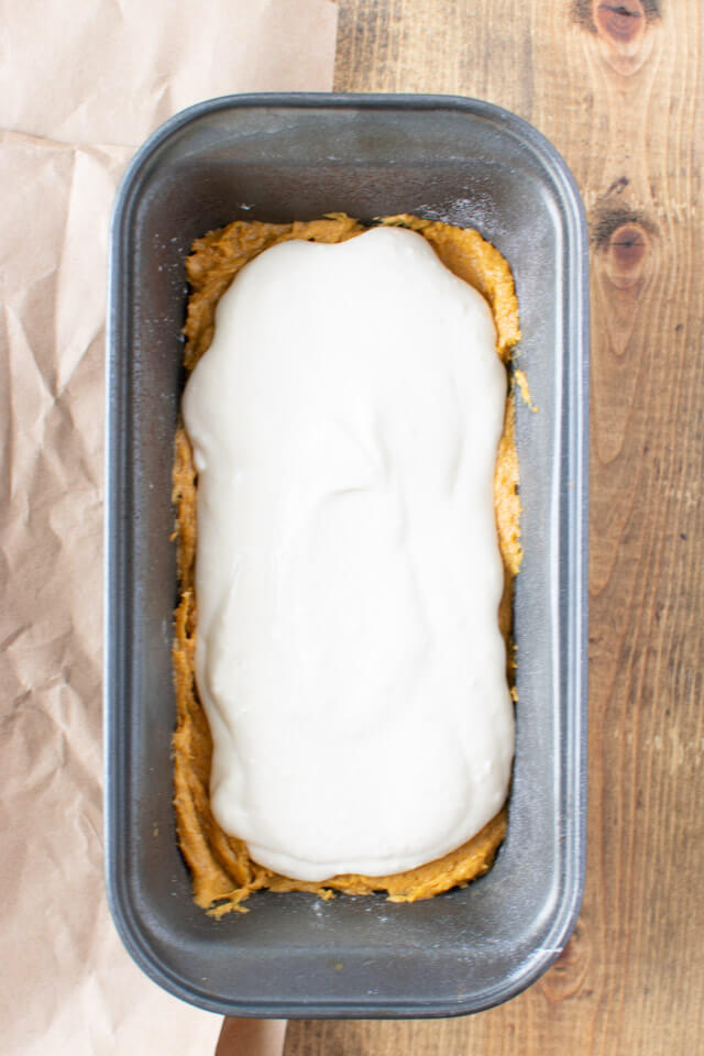 pumpkin batter topped with cheesecake batter in loaf pan