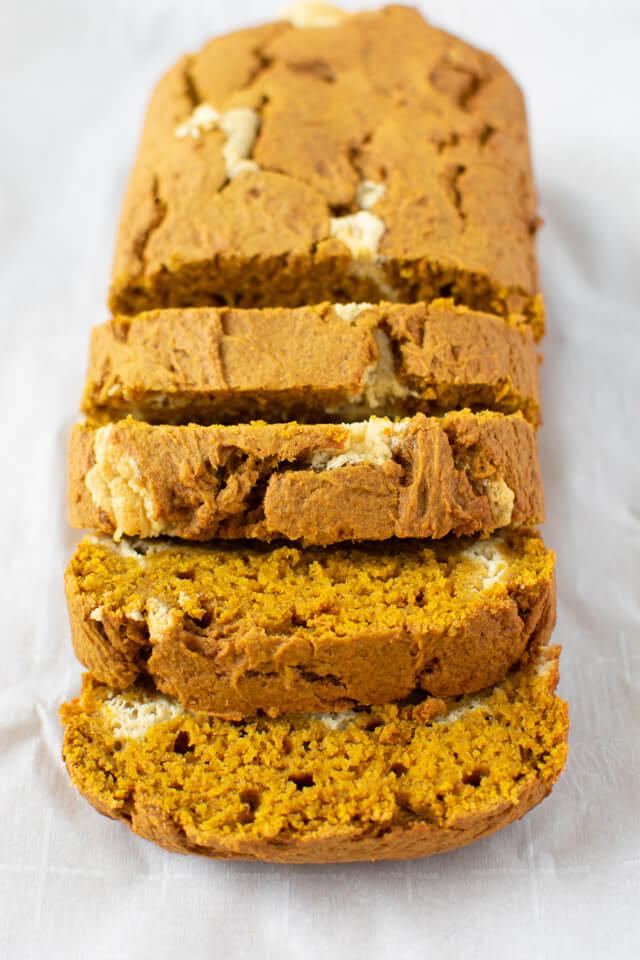 pumpkin cheesecake bread cut into slices