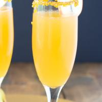 Closeup view of one glass of apple cider mimosa