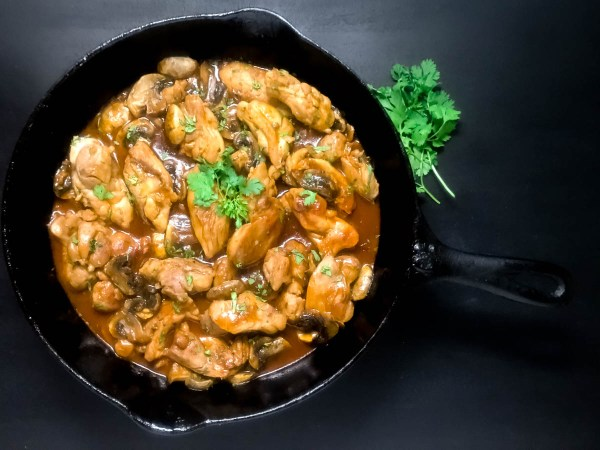 Zesty Skillet Chicken Thighs With Mushrooms from A Sprinkling of Cayenne food blog. | https://asprinklingofcayenne.com