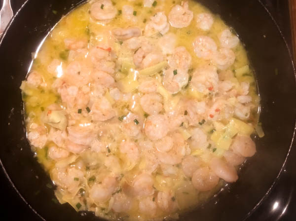 Gluten free shrimp scampi sauce ready and waiting for cooked spaghetti to soak up all of the yummy buttery garlic sauce. | https://asprinklingofcayenne.com