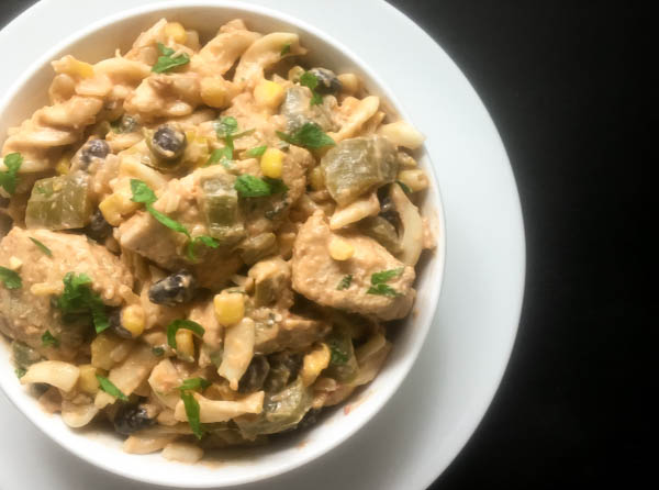 Hot and yummy bowl of gluten free chicken enchilada pasta bake. | http://asprinklingofcayenne.com