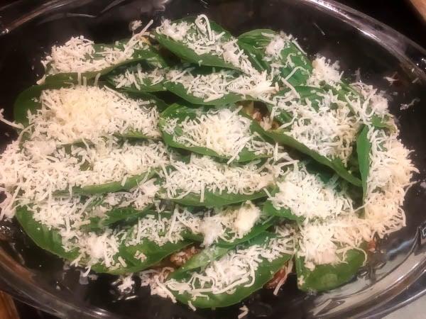 Layers of homemade Bolognese sauce and fresh basil leaves for Gluten Free Roasted Garlic & Basil Italian Pasta Bake.   http://asprinkilngofcayenne.com