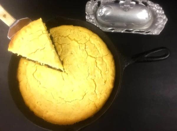 A piece of Gluten Free Skillet Cornbread being served. | https://asprinklingofcayenne.com