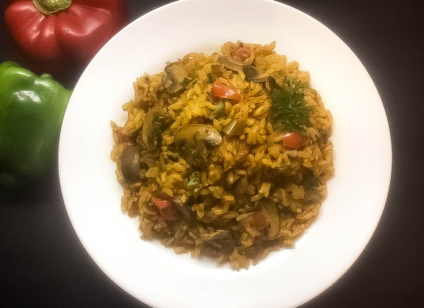 Plate of Cajun Trinity Turmeric Rice With Mushrooms from A Sprinkling of Cayenne. | https://asprinklingofcayenne.com
