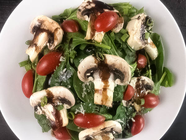 One yummy plate of Easy Spinach Salad With Tangy Balsamic Dressing from A Sprinkling of Cayenne. | https://asprinklingofcayenne.com