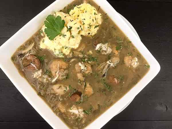 A big yummy bowl of Paleo Seafood Gumbo With 'Riced' Cajun Cauliflower Salad from A Sprinkling of Cayenne. | https://asprinklingofcayenne.com