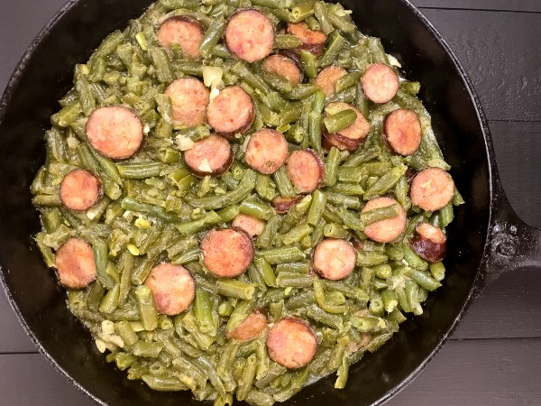 Closeup of gluten free, grain free Cajun Smothered Green Beans With Sausage from A Sprinkling of Cayenne. | http://asprinklingofcayenne.com