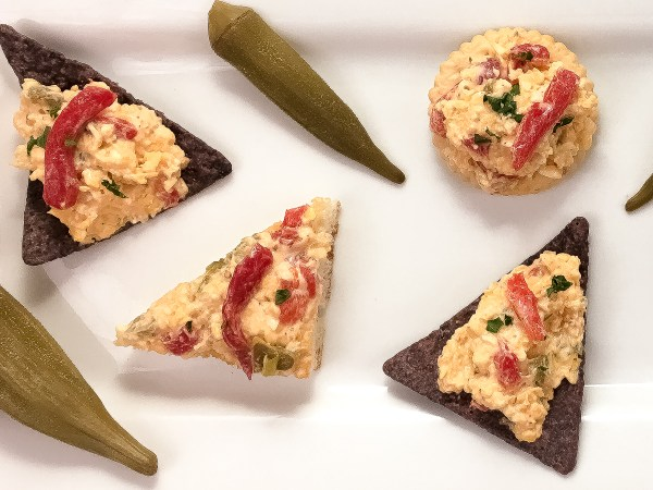 Cajun 'Caviar of the South' Pimento Cheese on crackers, toast points, and tortilla chips with pickled okra