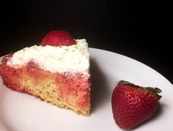 A piece of Gluten Free Strawberry Cornbread Poke Cake from A Sprinkling of Cayenne food blog. | https://asprinklingofcayenne.com