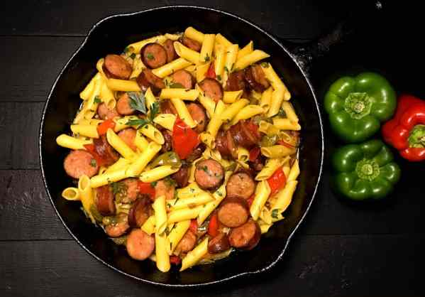 Gluten Free Cajun Sausage and Peppers Pasta from A Sprinkling of Cayenne. | https://asprinklingofcayenne.com