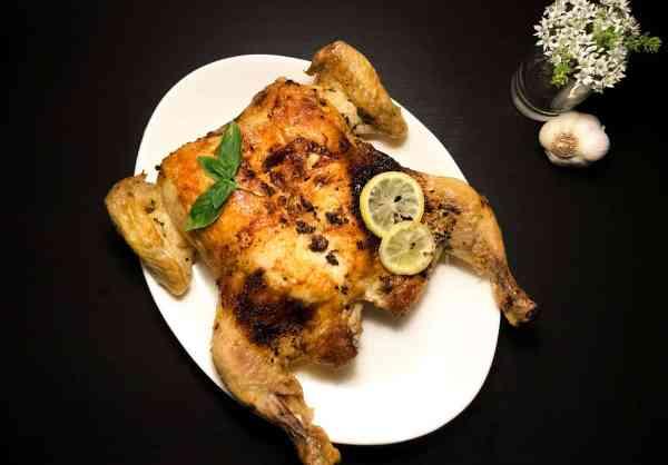 Roasted Garlic, Basil, and Lemon Spatchcock Chicken. | http://asprinklingofcayenne.com