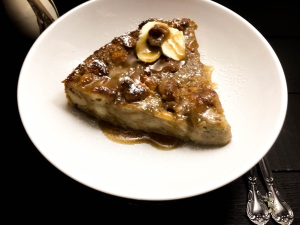 Angled side shot of Gluten Free Bananas Foster Bread Pudding. | https://asprinklingofcayenne.com