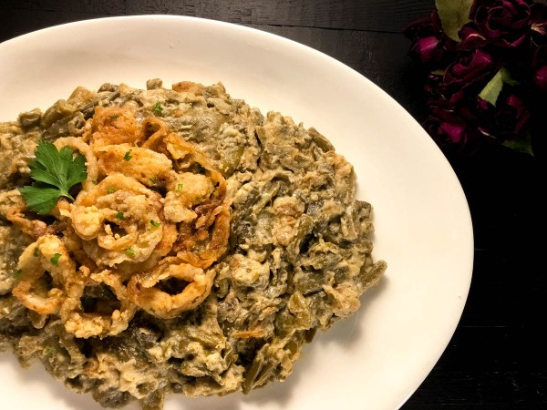 A plate of yum-delicious Gluten Free Cajun Smothered Green Bean Casserole from A Sprinkling of Cayenne.   https://asprinklingofcayenne.com