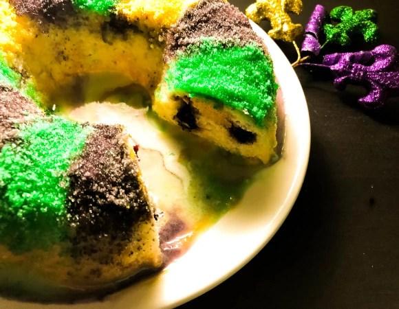 Side shot of Blueberry Cream Cheese Gluten Free King Cake Bundt Cake from A Sprinkling of Cayenne.com | https://asprinklingofcayenne.com