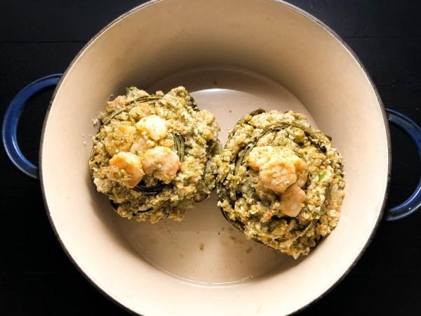 Gluten Free Shrimp Stuffed Artichokes in a water bath. https://asprinklingofcayenne.com