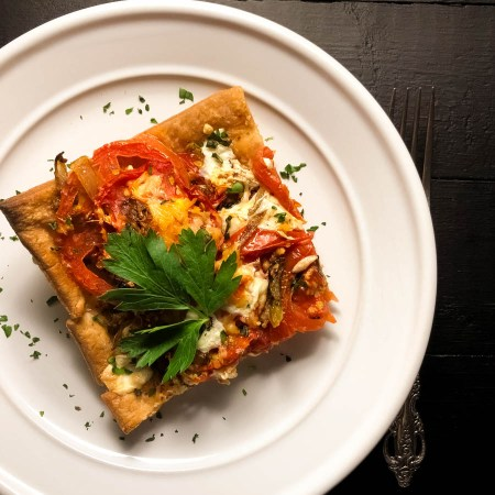 A piece of Gluten Free Garden Creole Tomato Tart. | https://asprinklingofcayenne.com