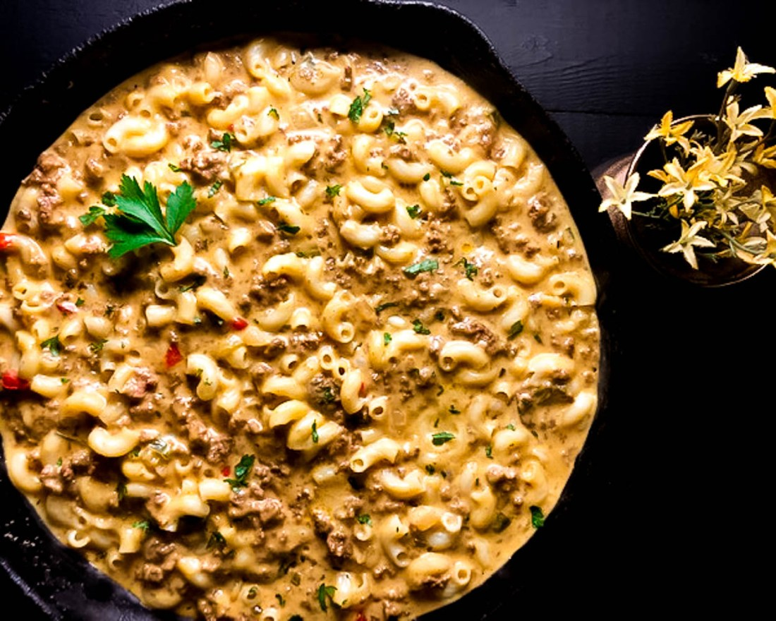 Best Ever Cheeseburger Macaroni Skillet against a black background