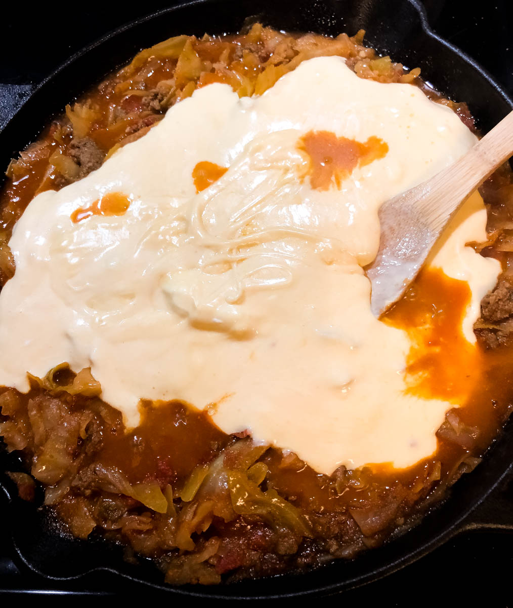 Cheesy sauce over skillet casserole.
