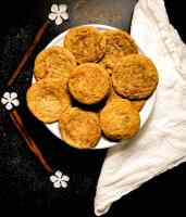 A plate of best ever soft gluten free Snickerdoodles cookies on a white plate against a black background.